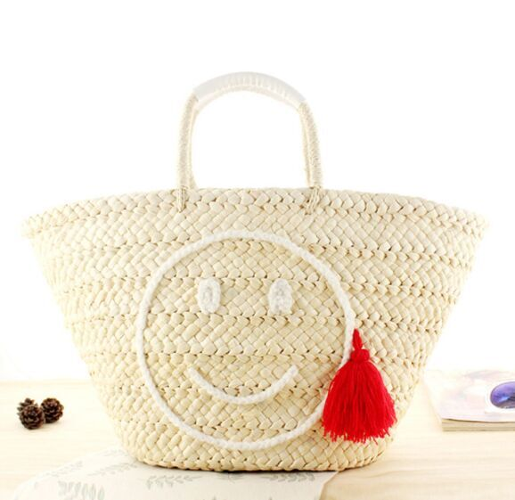 2018 Fashion Straw handbags Smile embroidery with Tassel bulk natual color